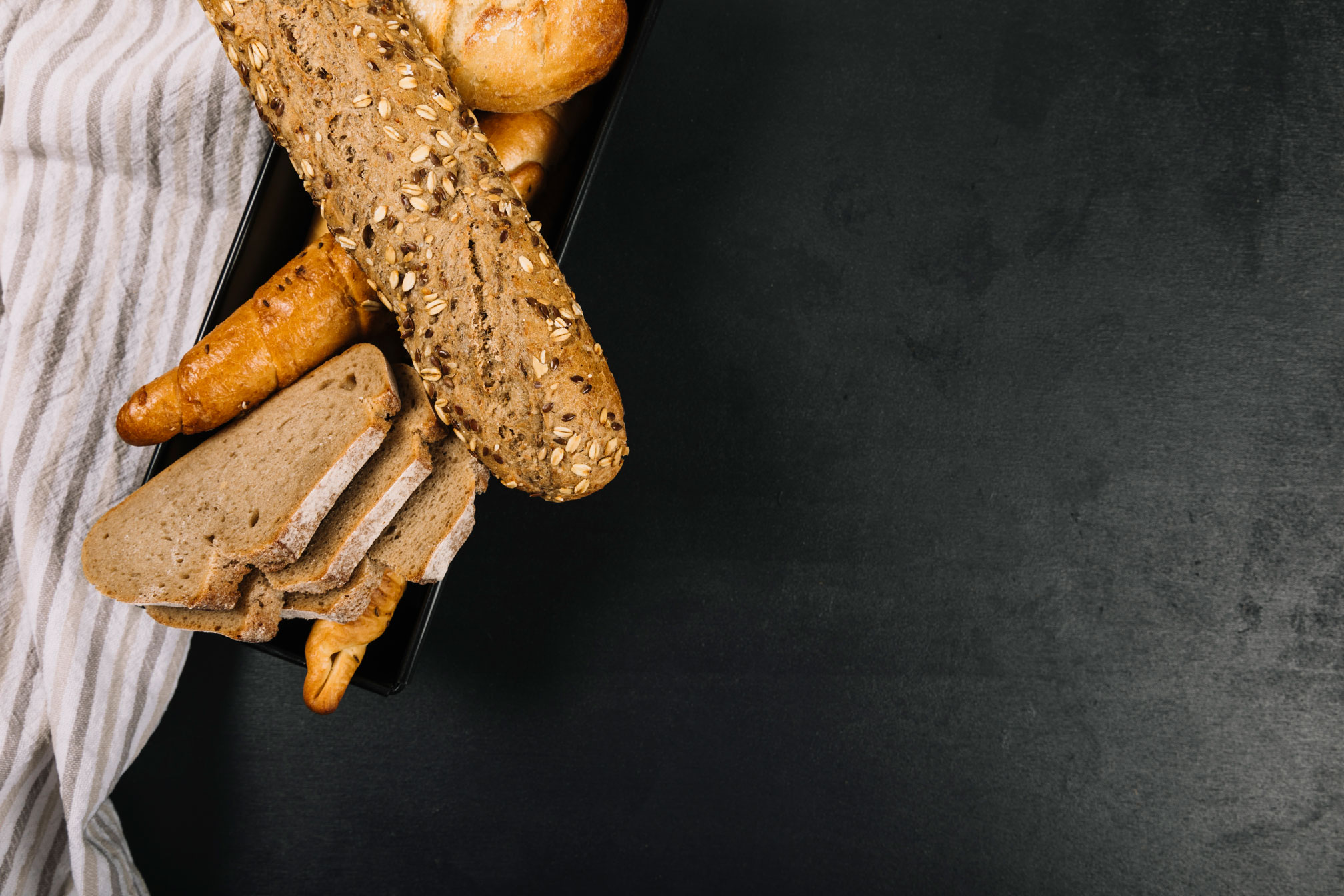 different types of bread on a black table chalkboard
