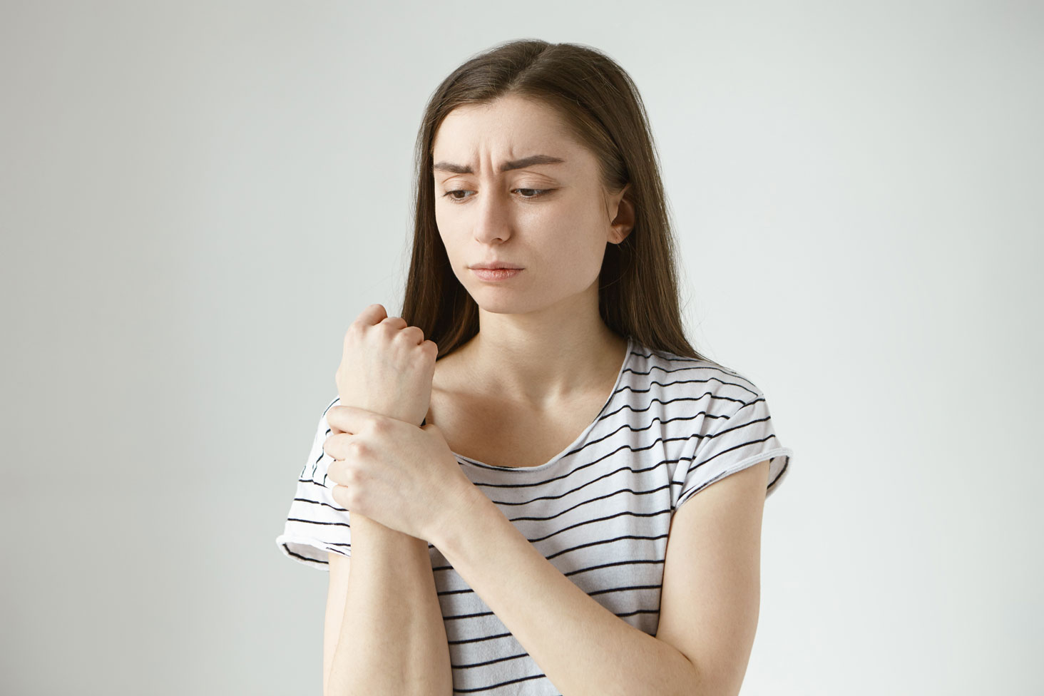 sad frustrated woman joint pain RA