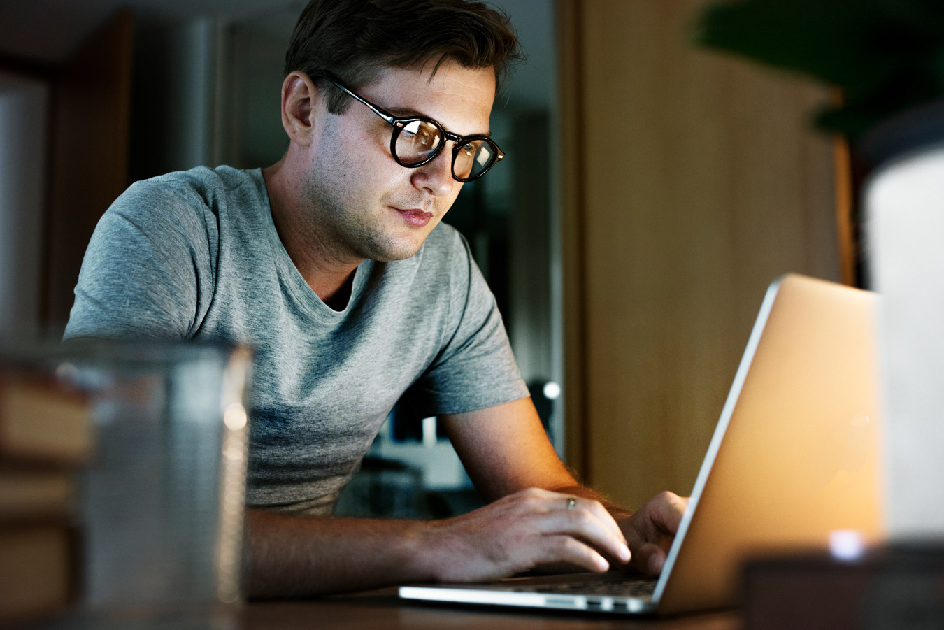 man with glasses working in front of a laptop eye strain