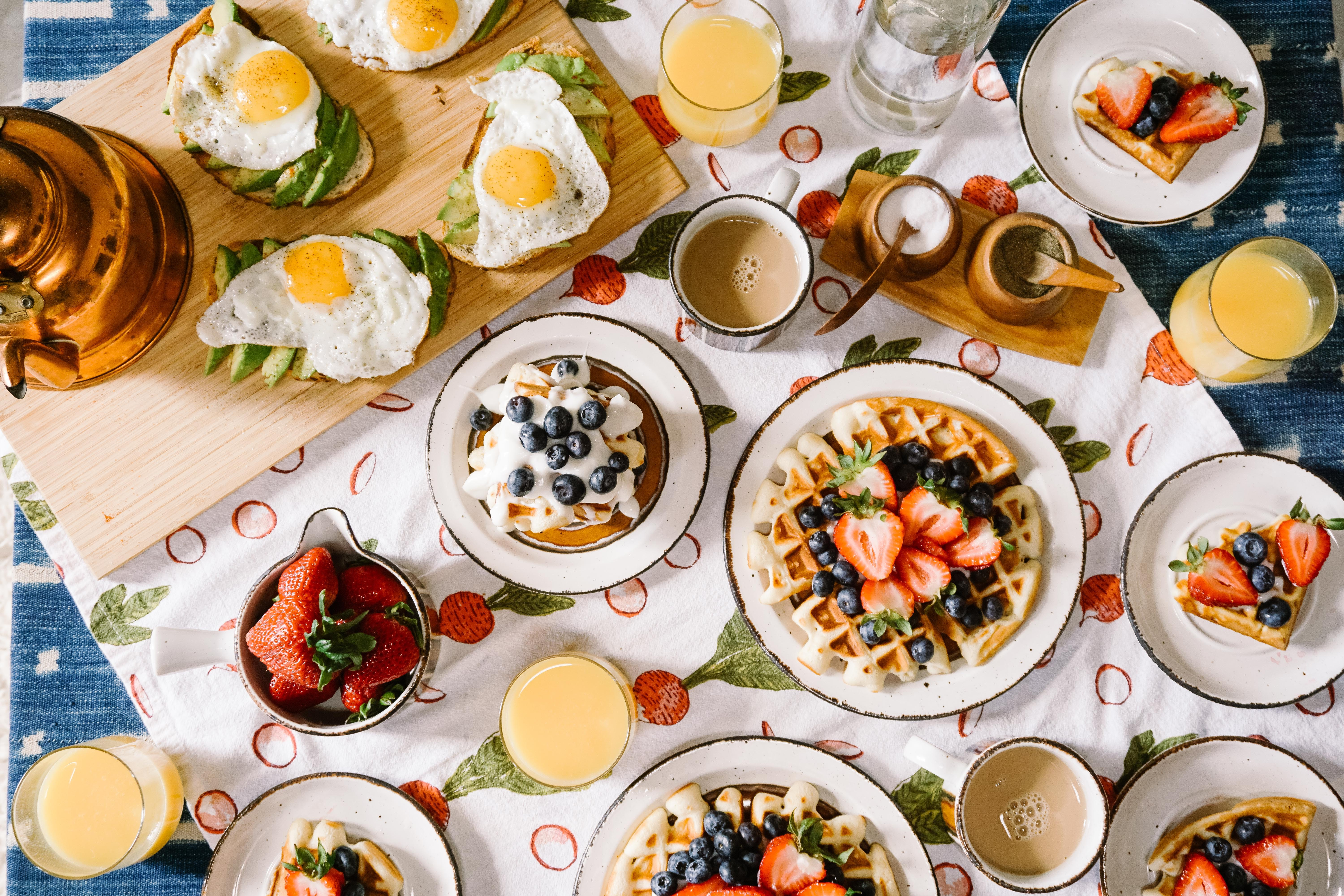 american breakfast with waffles avocado toast and fruits