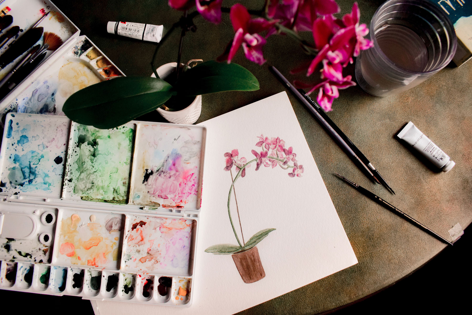 watercolor painting of a flower in a sketch book