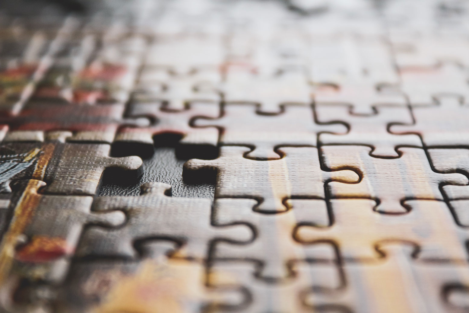 close up shot of a puzzle with a missing piece