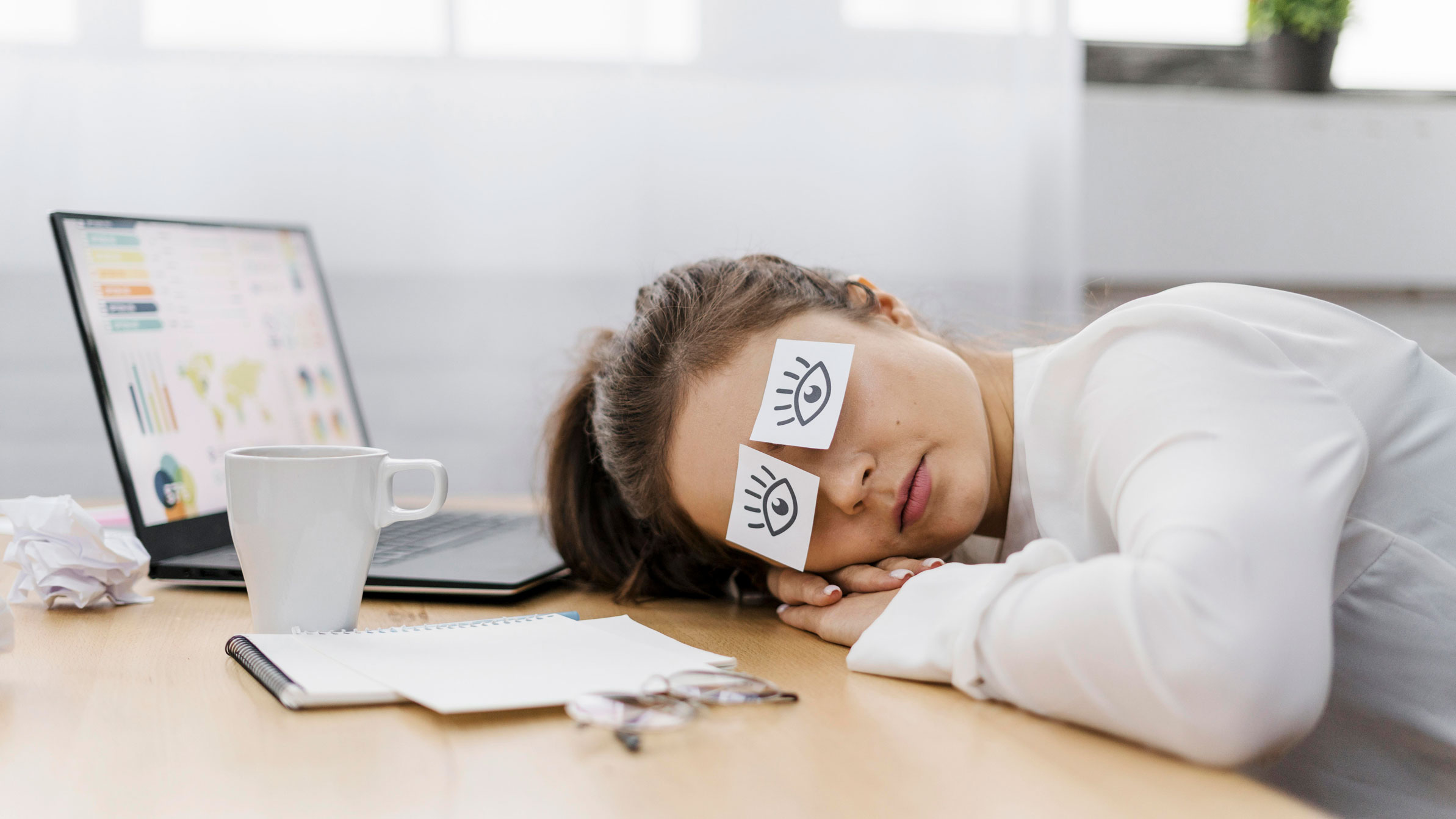 tired business woman covering her eyes