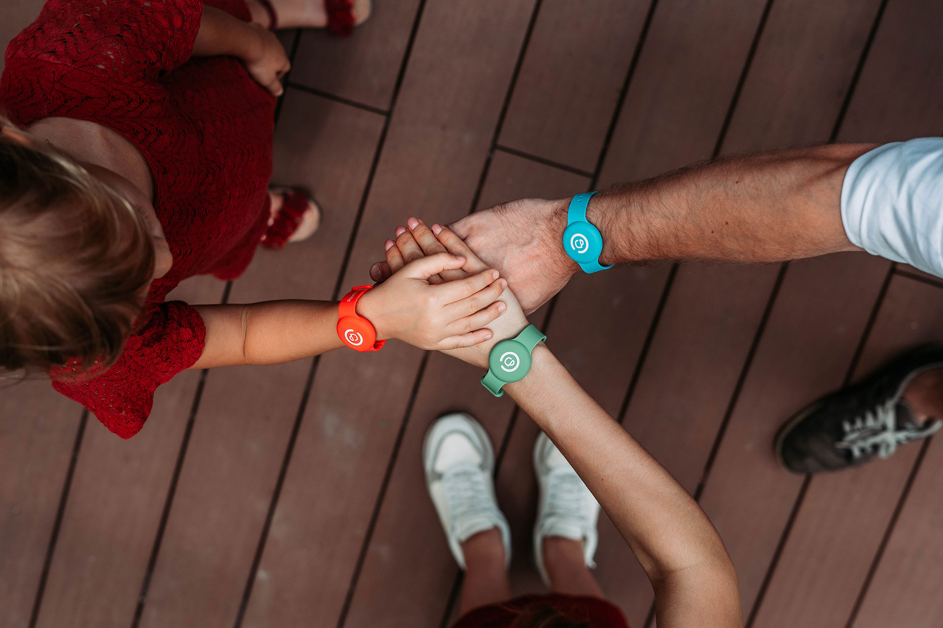 family hands together pouchpass temperature monitoring wristband